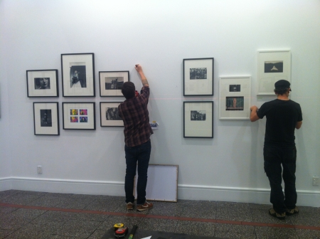 Ace exhibition installers Sam and Murray hanging the show.